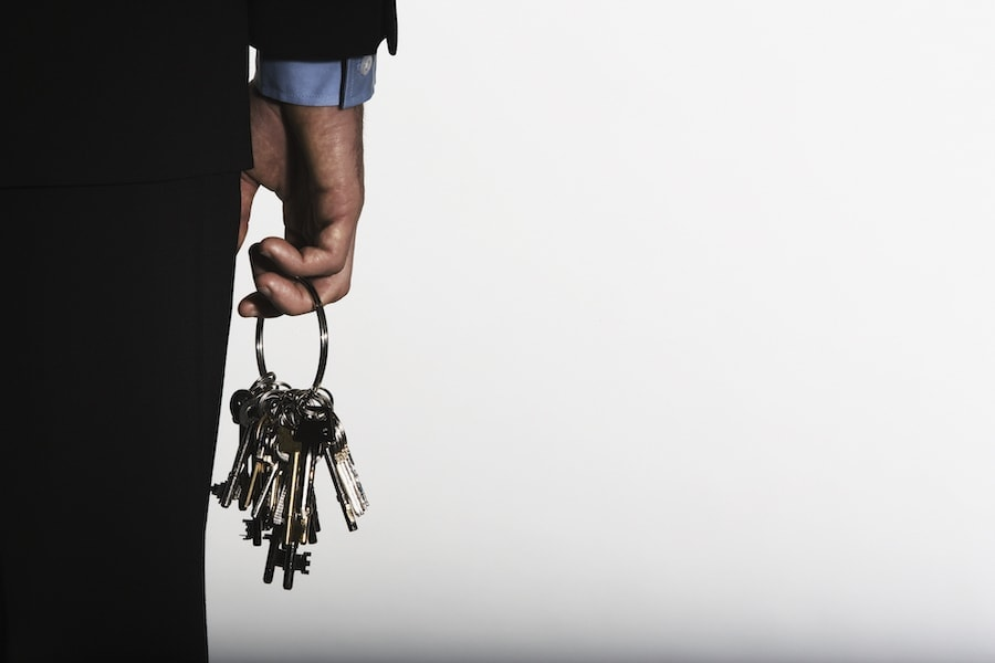 How Hand holding large ring of keys.Master Key Systems Work