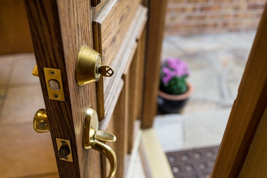 Front Door Left Open with Key in Lock.  Should You Have a Professional Locksmith Install Your Residential and Commercial Locks?   In our increasingly independent